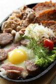 Meat with egg — Stock Photo