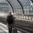 Men on trainstation — Stock Photo