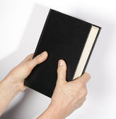 Bible in the hand — Stock Photo