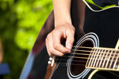 Playing Guitar — Stockfoto