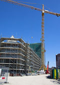 Constructionsite with bulding cranes — Stock Photo