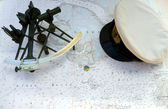 Sextant and Peaked Cap — Stock Photo