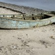 Stock Photo: Old Dinghy on Beach