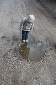 Child at the Puddle — Stock Photo