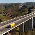 Yellow truck in bridge — Stock Photo