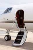 Private jet parked in front of hangar — Stock Photo