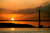 Lisbon bridge at sunset — Stock Photo
