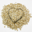 Royalty-Free Stock Photo: Heart filled with oatmeal surrounded by oatmeal