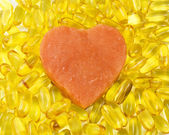 Salmon heart surrounded by salmon oil — Stock Photo