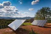 Solar power panels in a rural countryside — Stock Photo