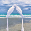 Wedding archway arranged on the sand - Stock Photo