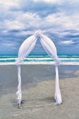 Wedding archway arranged on the sand — Stock Photo