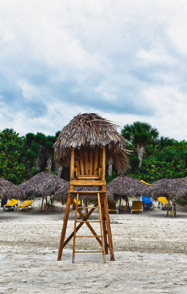 Lifeguard chair on an empty, stormy beach — Stock Photo #8644402
