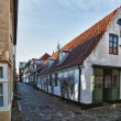 Street with old houses from royal town Ribe in Denmark - Stock Photo
