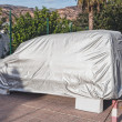 Car with cover — Stock Photo
