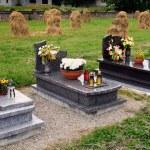 Graveyard with haystacks — Stock Photo