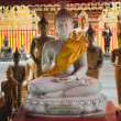 Golden buddha statues in Wat Phrathat Doi Suthep in Chiang Mai — Stock Photo #8884513