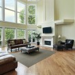Living room with two story windows - Stock Photo