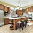 Kitchen with oak cabinetry - Stock Photo