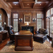 Library in luxury home — ストック写真