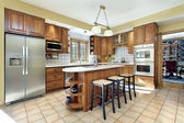Kitchen with oak cabinetry — Stock Photo