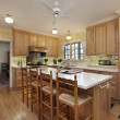 Kitchen with oak wood cabinetry — Stock Photo