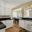 Kitchen with adjacent breakfast room — Stock Photo #8656357