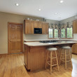 Kitchen with oak wood cabinetry — Stock Photo #8656380