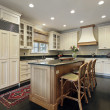 Kitchen with granite and wood island — Stock Photo #8656423
