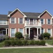 Brick home with front balcony — Stock Photo