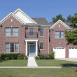 Brick home with white columns - Stock Photo