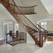Stock Photo: Foyer with curved staircase