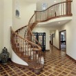 Large foyer with circular staircase — Stock Photo