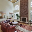 Family room with two story brick fireplace — Stok fotoğraf
