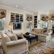 Foto Stock: Family room with built in cabinets