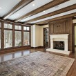 Family room with wood ceiling beams — Stock Photo #8658473