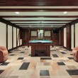 Pool room with wood beam ceilings - Stock Photo