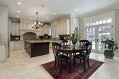 Large kitchen with island — Stock Photo