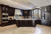 Large kitchen in luxury home — 图库照片