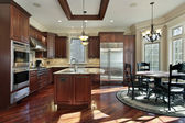 Luxury kitchen with cherry wood cabinetry — Stock Photo