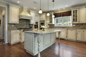 Kitchen with large granite island — Stock fotografie