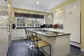 Kitchen with granite counter — Stock Photo