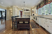Large kitchen with white cabinetry — Stock Photo