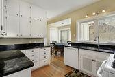 Kitchen with adjacent breakfast room — Stock Photo