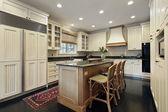 Kitchen with granite and wood island — Stock Photo