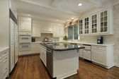 Kitchen with cream colored cabinetry — Stock Photo