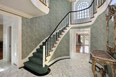 Foyer with green stairs — Stock Photo