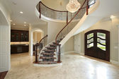 Foyer with curved staircase — Stock Photo