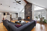 Family room with two story stone fireplace — Stock Photo