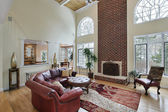 Family room with two story brick fireplace — Stock Photo